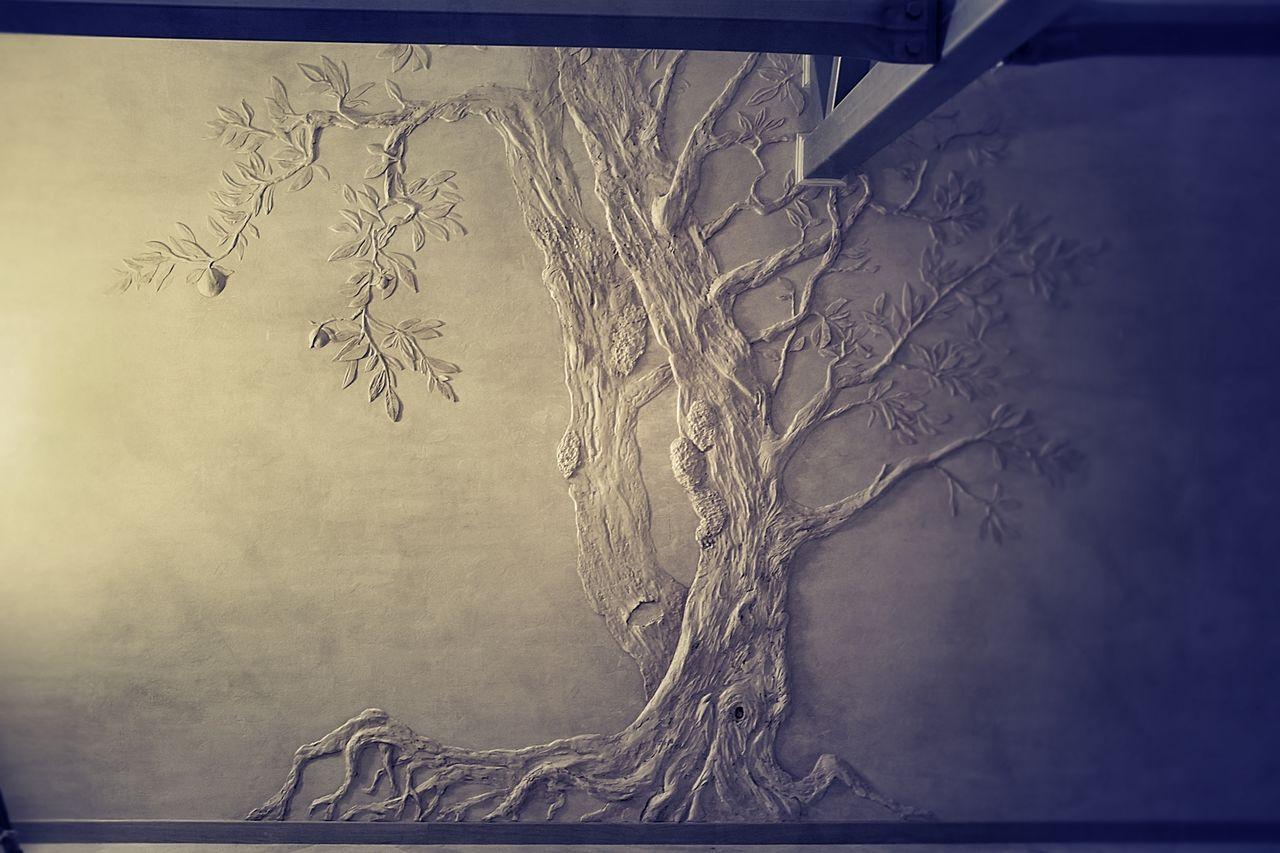 узоры штукатуркой на стене