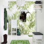 Фотообои с рисунком зеленых листьев.